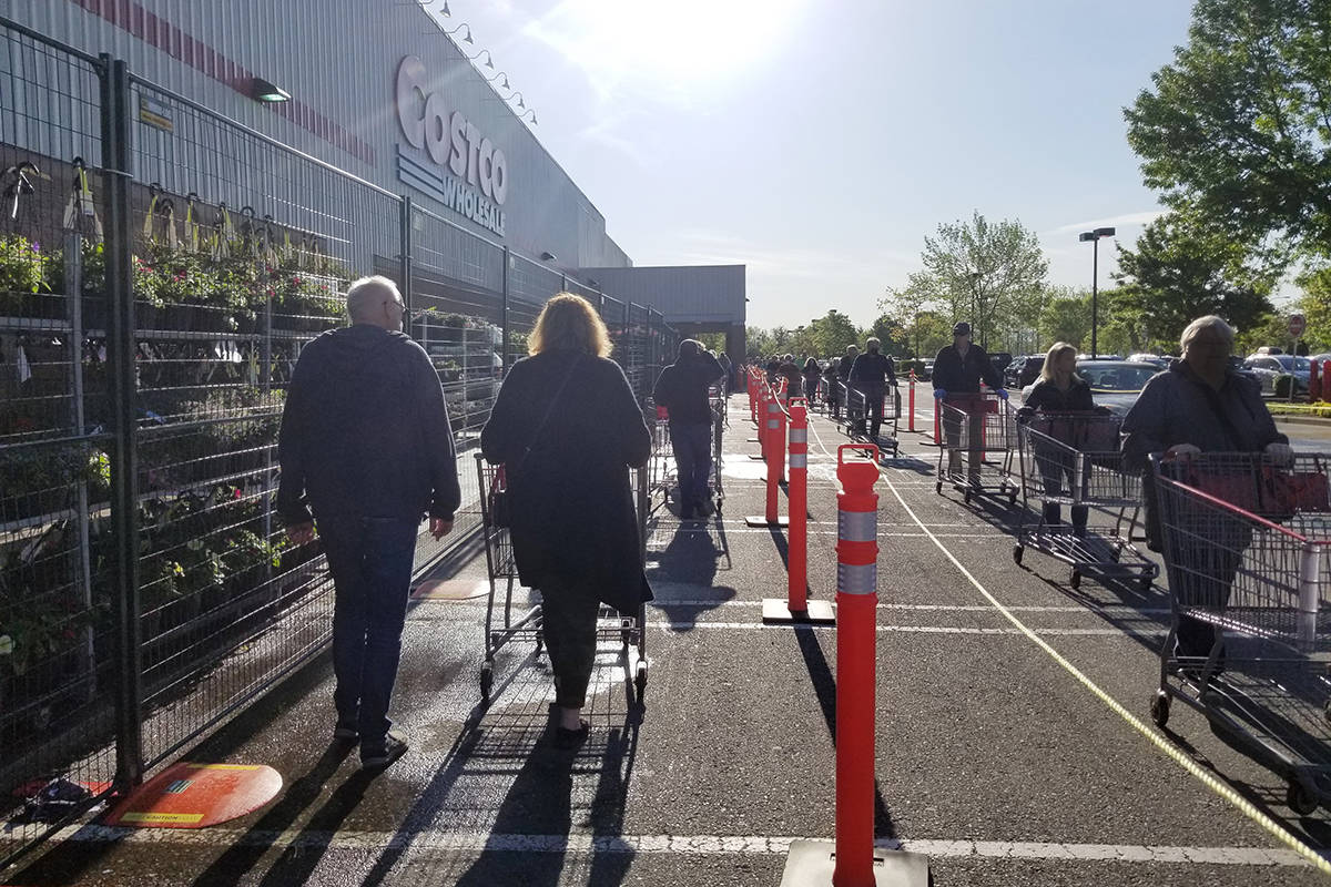 Members queue up at the Langley Costco in May of 2020. Four staff at the store tested positive for the coronavirus over two weeks in November, said an employee who did not want to be named for fear of losing their job (Langley Advance Times file)