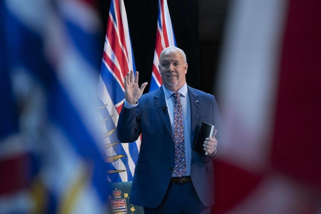 Janet Austin, the lieutenant-governor of British Columbia, not seen, swears in Premier John Horgan during a virtual swearing in ceremony in Victoria, Thursday, Nov. 26, 2020. Horgan says he will look to fill gaps in the federal government's sick-pay benefits program aimed at preventing the spread of COVID-19. THE CANADIAN PRESS/Jonathan Hayward