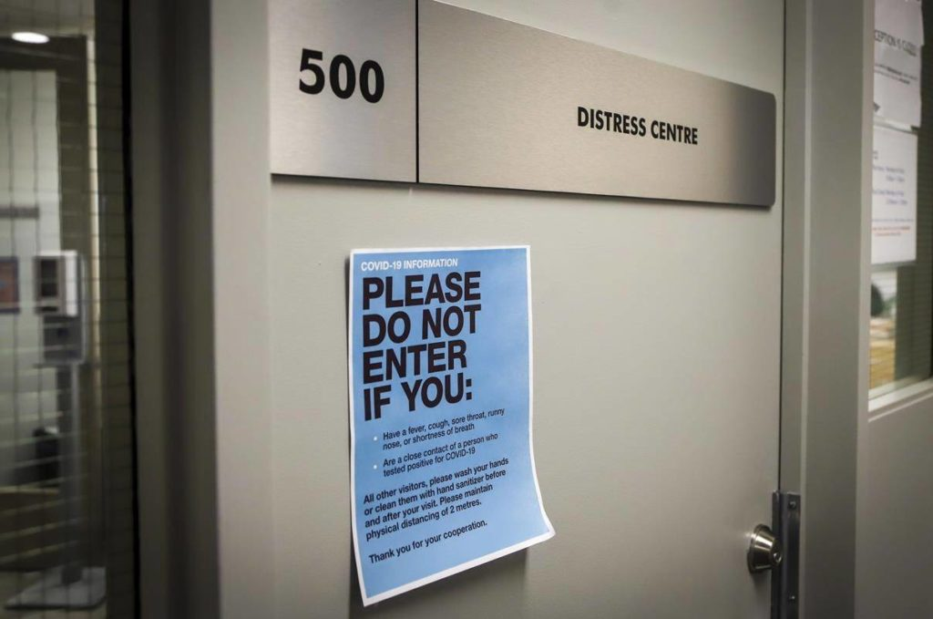 Signage for the Distress Centre in Calgary, Alta., is shown on Wednesday, Dec. 2, 2020. Distress Centre Calgary says suicide-related calls, texts and chats were up 66 per cent in October compared with the same month in 2019. THE CANADIAN PRESS/Jeff McIntosh