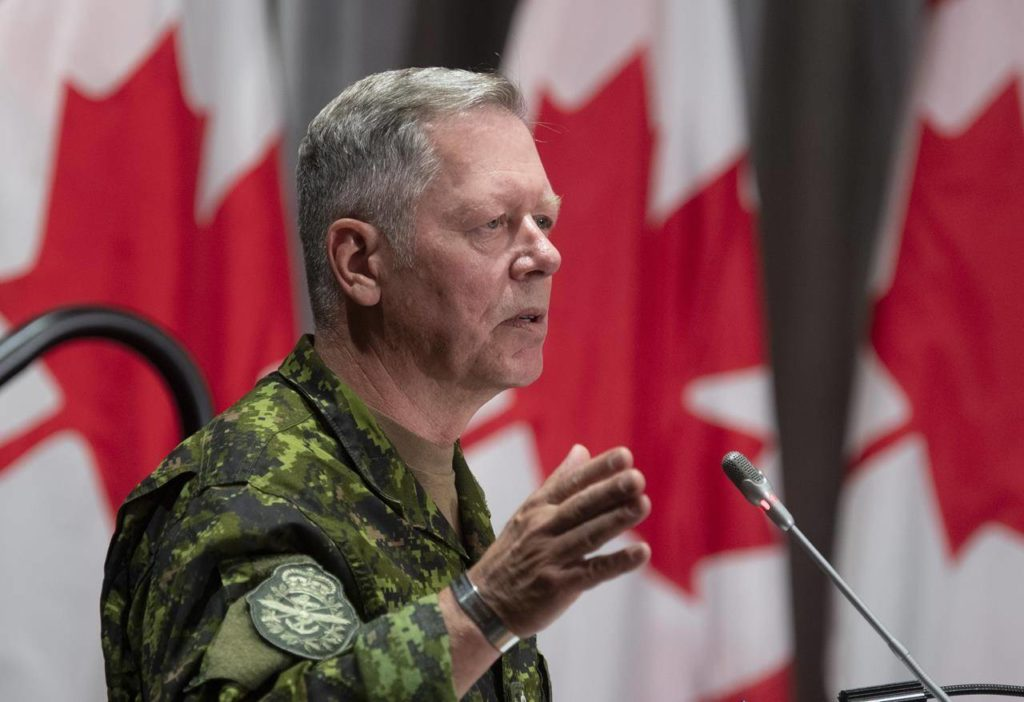 Chief of Defence Staff Gen. Jonathan Vance responds to a question during a news conference Friday, June 26, 2020 in Ottawa. Vance is ordering his troops to be ready to pick up COVID-19 vaccines in the U.S. and Europe on short notice, and prepare to help distribute the doses while responding to floods and other emergencies. THE CANADIAN PRESS/Adrian Wyld