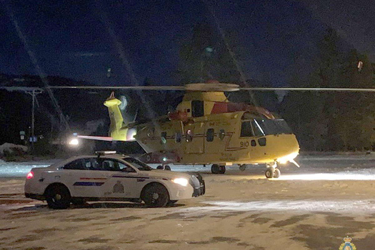 An RCMP cruiser looks on as military search and rescue helicopter powers down outside Bridesville Tuesday night, Dec. 1. Photo courtesy of RCMP Cpl. Jesse O'Donaghey