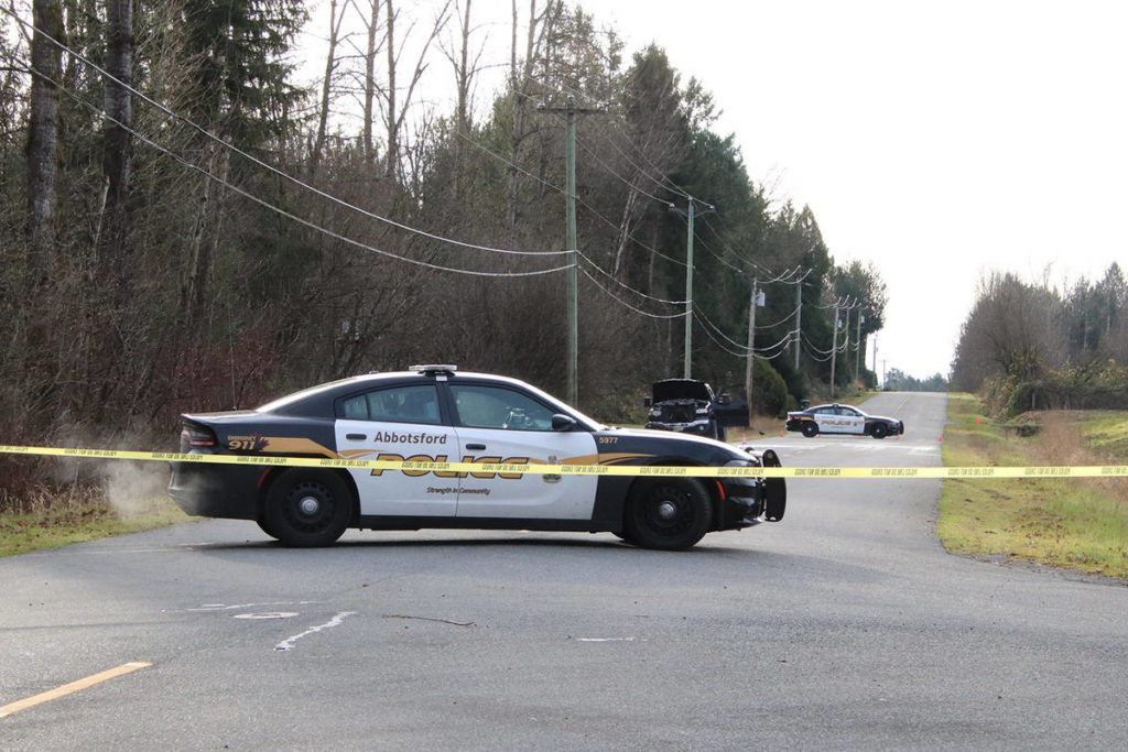 Lefeuvre Road, near Myrtle Avenue, was blocked to traffic on Thursday (Dec. 3) after an abandoned pickup truck was found on fire. Police are investigating to determine if there are any links to a killing an hour earlier in Surrey. (Shane MacKichan photo)