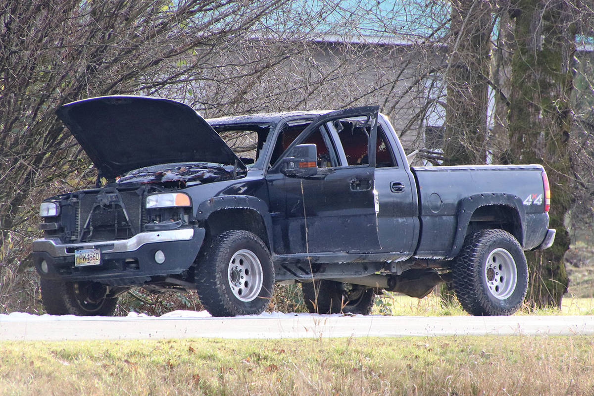 An abandoned pickup truck was found on fire Thursday morning (Dec. 3) on Lefeuvre Road, near Myrtle Avenue. Police are investigating to determine if there are any links to a killing an hour earlier in Surrey. (Shane MacKichan photo)