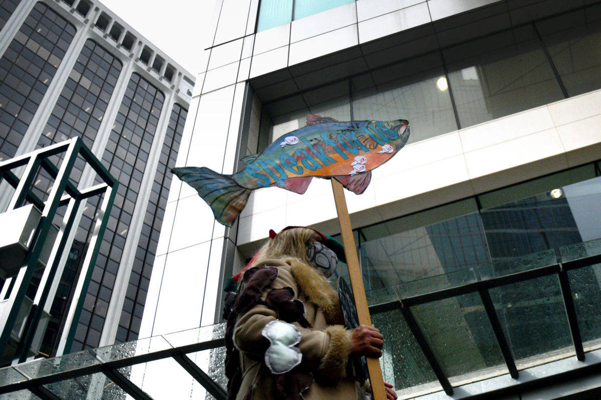 A demonstrator wears representations of sea lice outside the Fisheries and Oceans Canada offices in downtown Vancouver Sept. 24, demanding more action on the Cohen Commission recommendations to protect wild Fraser River sockeye. (Quinn Bender photo)
