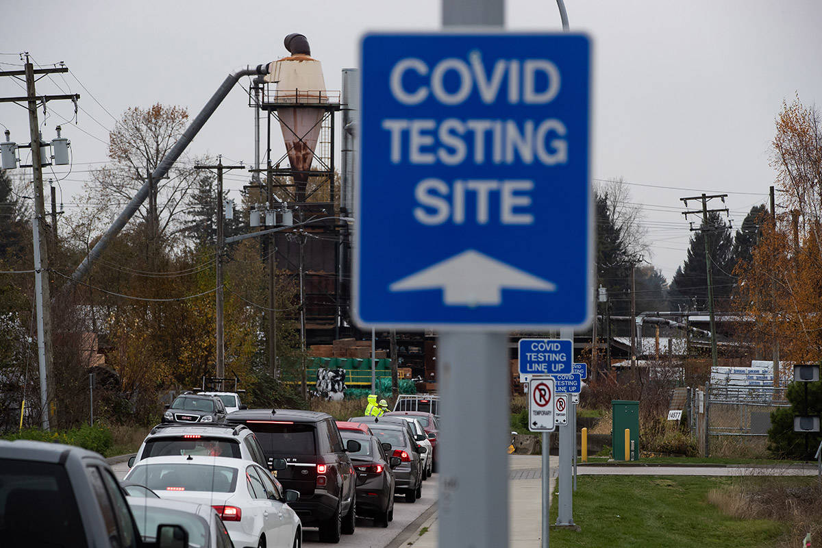 Motorists wait to enter a Fraser Health COVID-19 testing facility, in Surrey, B.C., on Monday, Nov. 9, 2020. THE CANADIAN PRESS/Darryl Dyck