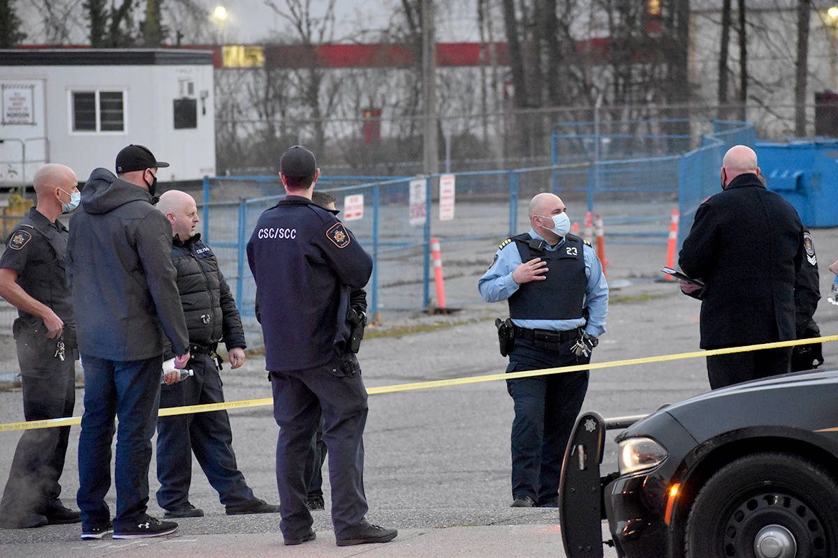 Cops converge in a Marshall Road parking lot on Thursday afternoon (Dec. 3) after an inmate escaped from corrections officers. The man was taken back into custody a short while later. (Ben Lypka/Abbotsford News)