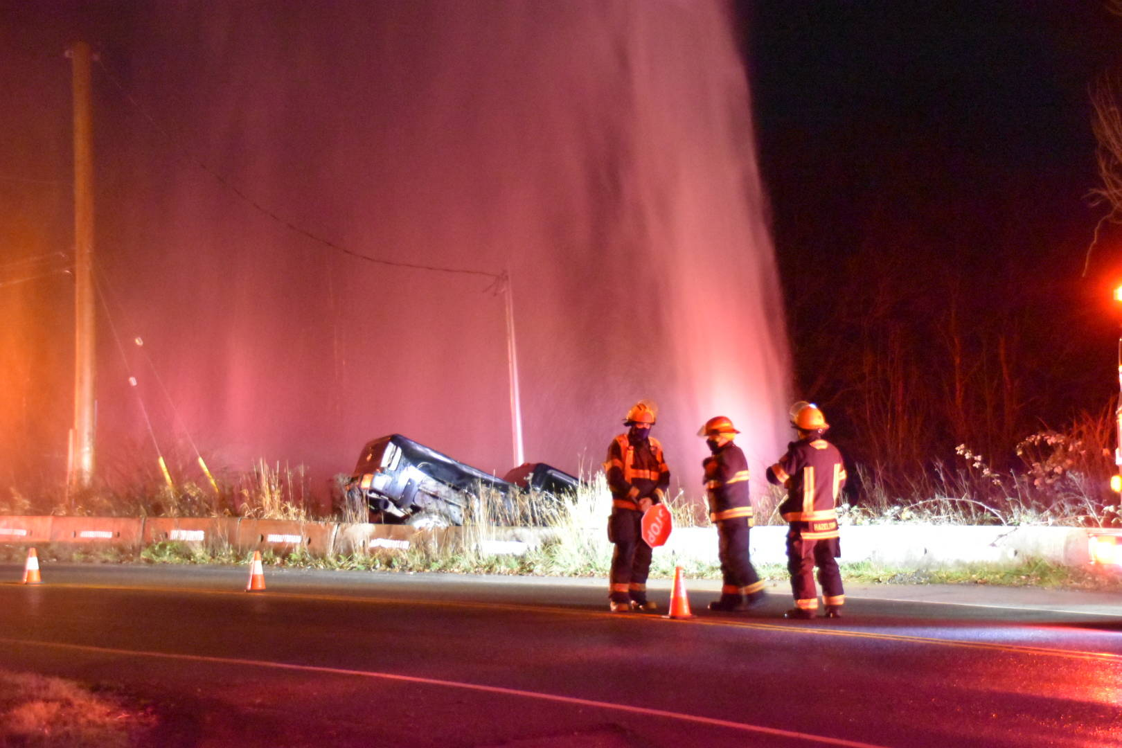 Township of Langley firefighters were called to a crash Thursday, Dec. 3, 2020 where the lone driver of a pickup truck damaged a water main leaving Trinity Western University without water. (Curtis Kreklau/Special to Langley Advance Times)