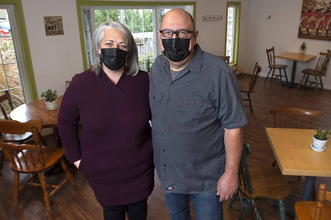 Melissa Velden and her chef-husband Chris Velden, stand in their dining room at the Flying Apron Inn and Cookery in Summerville, N.S. on Friday, Nov. 20, 2020. The couple is hosting holiday parties with appropriate distancing and other COVID-19 health protocols in place at their restaurant. THE CANADIAN PRESS/Andrew Vaughan