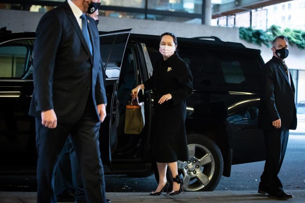 Meng Wanzhou, chief financial officer of Huawei, arrives at B.C. Supreme Court to attend a hearing, in Vancouver, on Friday, November 27, 2020. The U.S. Department of Justice is refusing to comment on media reports that its lawyers are seeking a plea deal of sorts with Chinese tech executive Meng Wanzhou. THE CANADIAN PRESS/Darryl Dyck