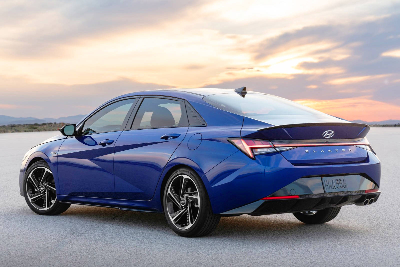 The 2021 Hyundai Elantra features attractive side creases extending along the door and rear-fender panels that blend into a knife-edged trunk lid.