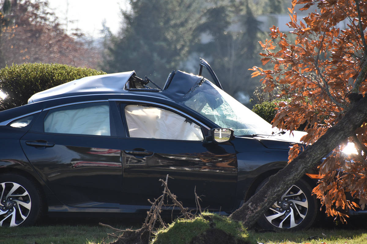At least one person received life-threatening injuries when a car collided with a semi truck in South Surrey on Friday morning. (Curtis Kreklau photo)