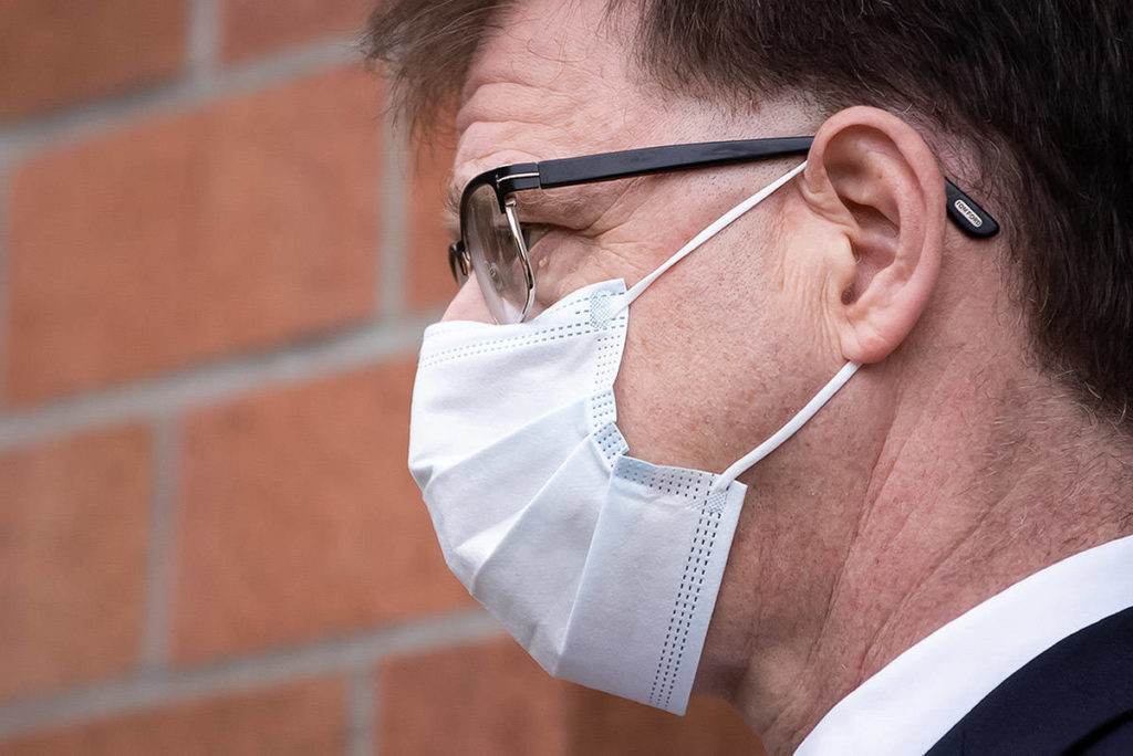 British Columbia Health Minister Adrian Dix wears a face mask to curb the spread of COVID-19, during an announcement about a new regional cancer centre, in Surrey, B.C., on Thursday, August 6, 2020. THE CANADIAN PRESS/Darryl Dyck