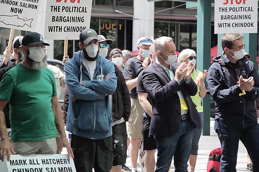 Demonstrators, organized by the Public Fishery Alliance, outside the downtown Vancouver offices of Fisheries and Oceans Canada July 6 demand the marking of all hatchery chinook to allow for a sustainable public fishery while wild stocks recover. (Public Fishery Alliance Facebook photo)