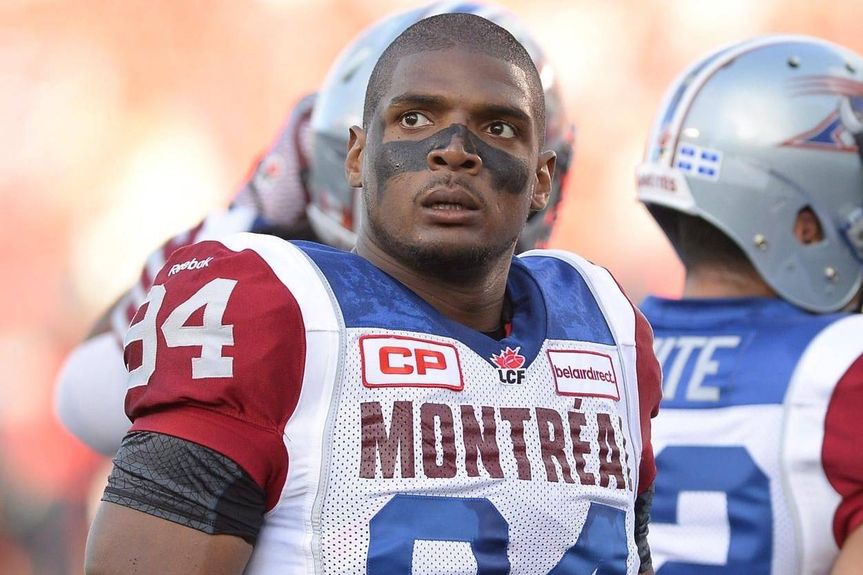 Montreal Alouettes' Michael Sam is set to make his pro football debut as he warms up before the first half of a CFL game against the Ottawa Redblacks in Ottawa on Friday, Aug. 7, 2015. Sam became the first publicly gay player to be drafted in the NFL. He signed with the Montreal Alouettes after being released by St. Louis, but abruptly left after playing one game. THE CANADIAN PRESS/Justin Tang