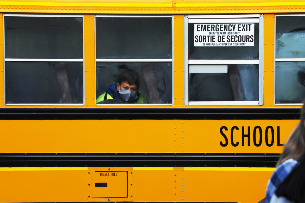 "Sept. 10, 2020 — In the photo is a W.L. McLeod student wearing a mask in a school bus, on his first day back-to-school. This year, due to COVID-19, students will have a different year than most. The President of B.C. Teachers' Federation told Black Press Sept. 9, that she had a lot of mixed feeling about how ready the education system is for students to be coming back-to-school. Meanwhile, Libby Hart, Principal of W.L. Mcleod Elementary School in Vanderhoof said,"" We know some of the families are still unsure, but most of our families have been great in connecting with us and talking to us."" Photos continued on Page 7. (Aman Parhar/Omineca Express)"