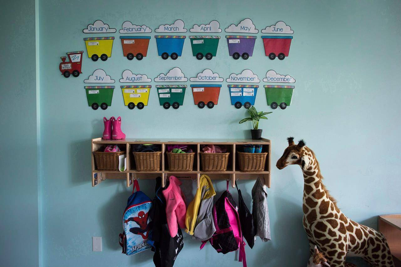 Children's backpacks and shoes are seen at a CEFA (Core Education and Fine Arts) Early Learning daycare franchise, in Langley, B.C., on May 29, 2018. THE CANADIAN PRESS/Darryl Dyck