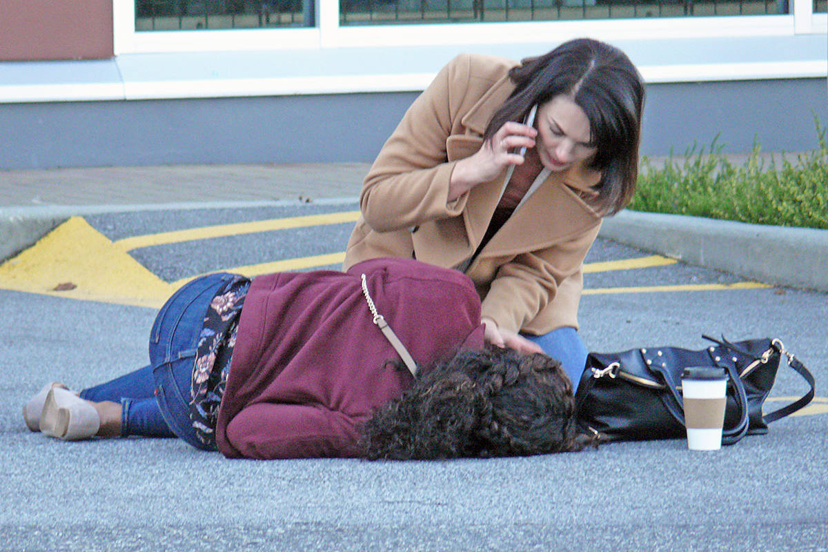 """Actor Rhonda Dent (with phone) , who grew up in Langley, returned to make """"Lethal Lesson,"""" a thriller shooting in Langley City on Nov. 25, 2020. (Dan Ferguson/Langley Advance Times)"""