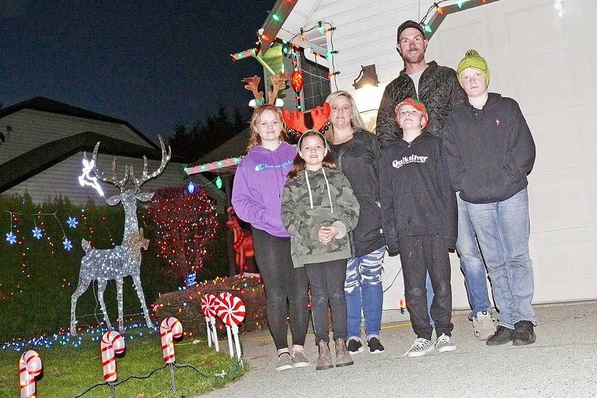 It's a family project: Makenna Mussato, 13, Kamryn, 9 and mom Jenn, with Jaxon Simpson, 9, dad Matt and Bryson, 12. For 17 years, the home at 26887 24A Avenue in Aldergrove has been the site of ever-more elaborate Christmas lights displays. (Dan Ferguson/Langley Advance Times)