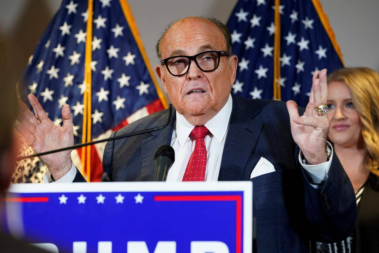 """FILE - In this Nov. 19, 2020, file photo, former New York Mayor Rudy Giuliani, a lawyer for President Donald Trump, speaks during a news conference at the Republican National Committee headquarters, in Washington. Giuliani urged Michigan Republican activists on Wednesday, Nov. 2, 2020, to pressure the GOP-controlled Legislature to """"step up"""" and award the state's 16 electoral votes to Trump despite Democrat Joe Biden's 154,000-vote victory. (AP Photo/Jacquelyn Martin, File)"""