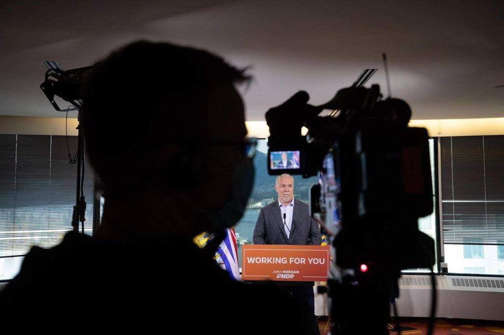 B.C. Premier John Horgan listens during a postelection news conference in Vancouver on Sunday, Oct. 25, 2020. Horgan says the election promise to provide COVID-19 recovery benefit dollars to British Columbia families and individuals will be the focus of Monday's return to the legislature for a brief session. THE CANADIAN PRESS/Darryl Dyck