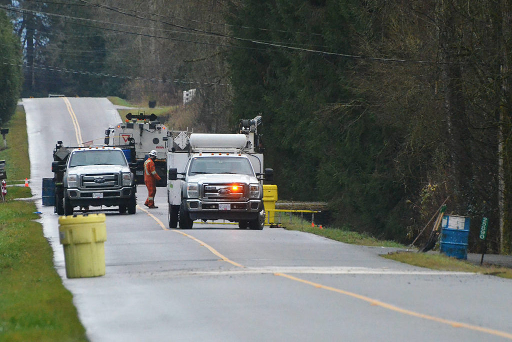 Township of Langley staff were on scene cleaning up after a number of barrels containing an unknown substance were dumped on 64th Avenue between 256th and 264th Avenues sometime early Monday morning. The yellow plastic drums contain clean up substances being deployed by the Township. (Matthew Claxton/Langley Advance Times)