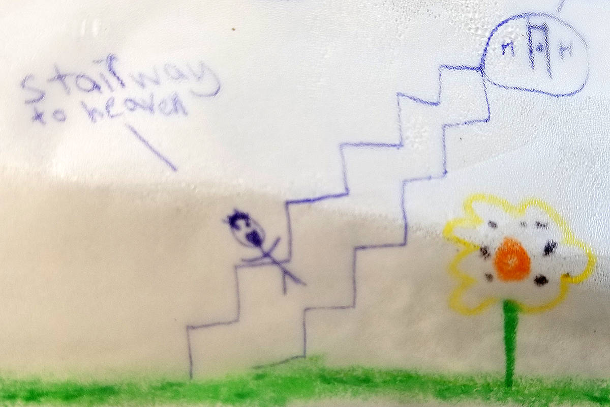 A hand-drawn 'stairway to heaven' was part of an memorial left for a cyclist who died from a medical emergency near 206th Street and 66th Avenue on Friday, Nov. 27, 2020 (Dan Ferguson/Langley Advance Times)