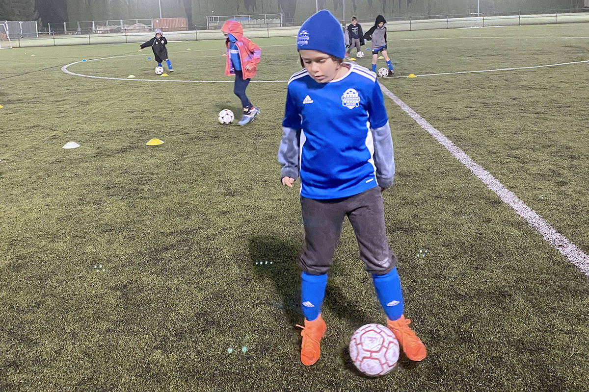 Aldergrove Youth Soccer player Parker Scott braved the rain to participate in a physically distant workout on Monday, Dec. 8, 2020. Under-19 player practices are still allowed under COVID guidelines. (Brian Hunter/special to Langley Advance Times)