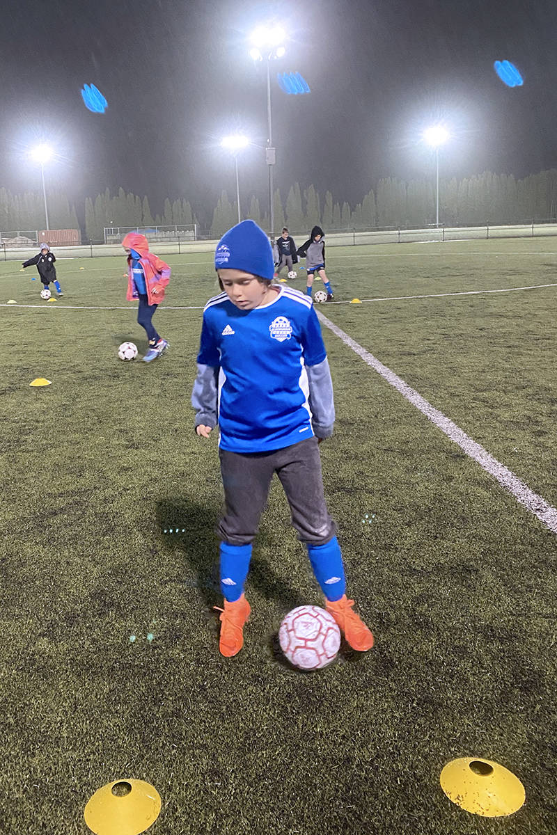 Aldergrove Youth Soccer player  Parker Scott  braved the rain to participate in a physically distant workout on Monday, Dec. 8.  Under-19 player practices are still allowed under COVID guidelines.  (Brian Hunter/special to Langley Advance Times)