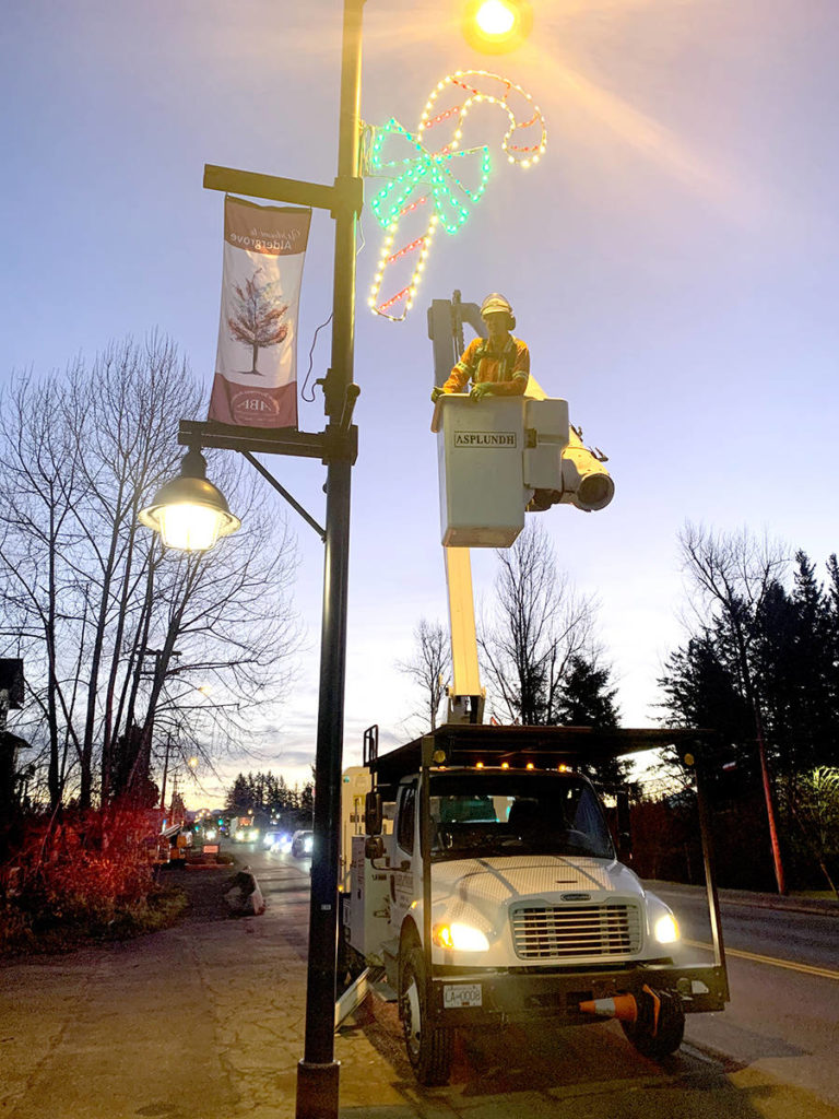 Asplundh Tree Services installed candy canes and wreaths on the light poles in downtown Aldergrove. (Doug Hadley/Special to the Aldergrove Star)