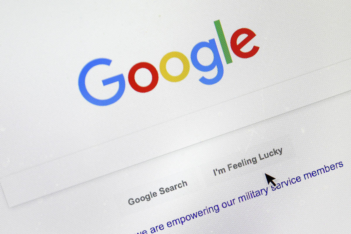 FILE - In this Tuesday, Aug. 28, 2018, file photo, a cursor moves over Google's search engine page, in Portland, Ore. (AP Photo/Don Ryan, File)