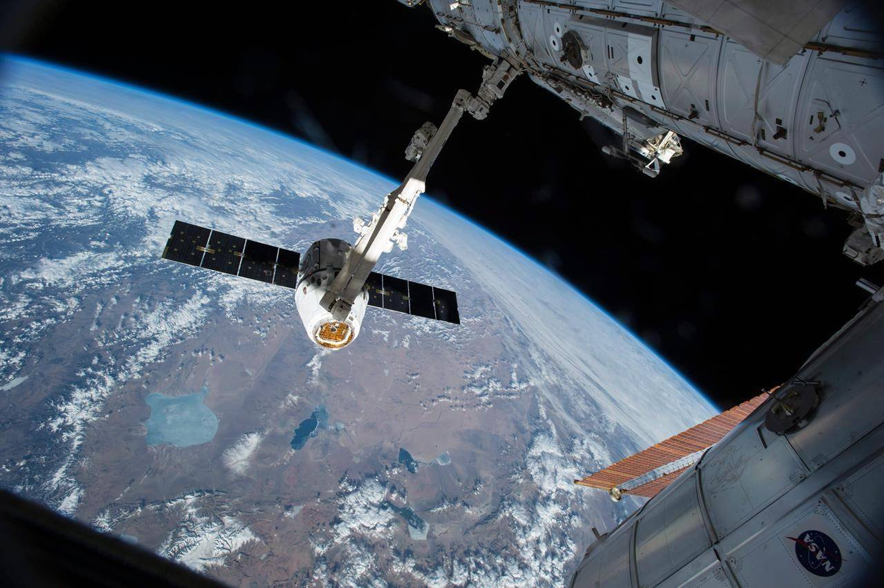 The Canadarm 2 reaches out to capture the SpaceX Dragon cargo spacecraft and prepare it to be pulled into its port on the International Space Station, Friday, April 17, 2015. The Canadian Space Agency has awarded a contract worth $22.8 million to MDA to develop Canadarm3. THE CANADIAN PRESS/AP-HO, NASA, *MANDATORY CREDIT*