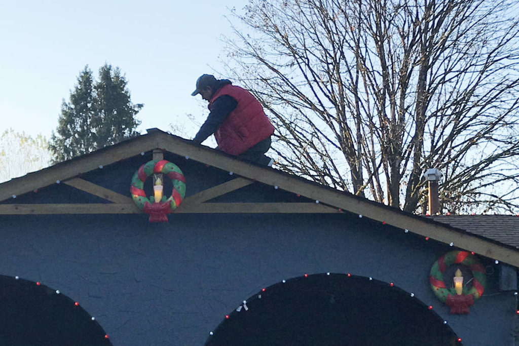 Bjorn Wejr putting in some necessary lighting work on the roof this season. (Special to The News)