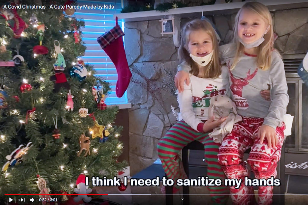 "Sisters Raleyn, 7, (L) and Makenna, 6, star in a home-made Christmas video titled ""A Covid Christmas."" (YouTube)"