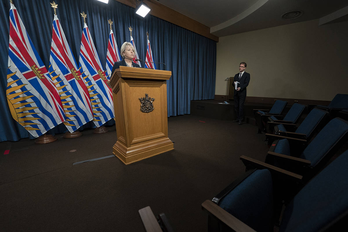 Health Minister Adrian Dix looks on as Dr. Bonnie Henry gives her daily media briefing regarding Covid-19 for the province of British Columbia in Victoria, B.C, Monday, December 7, 2020. THE CANADIAN PRESS/Jonathan Hayward