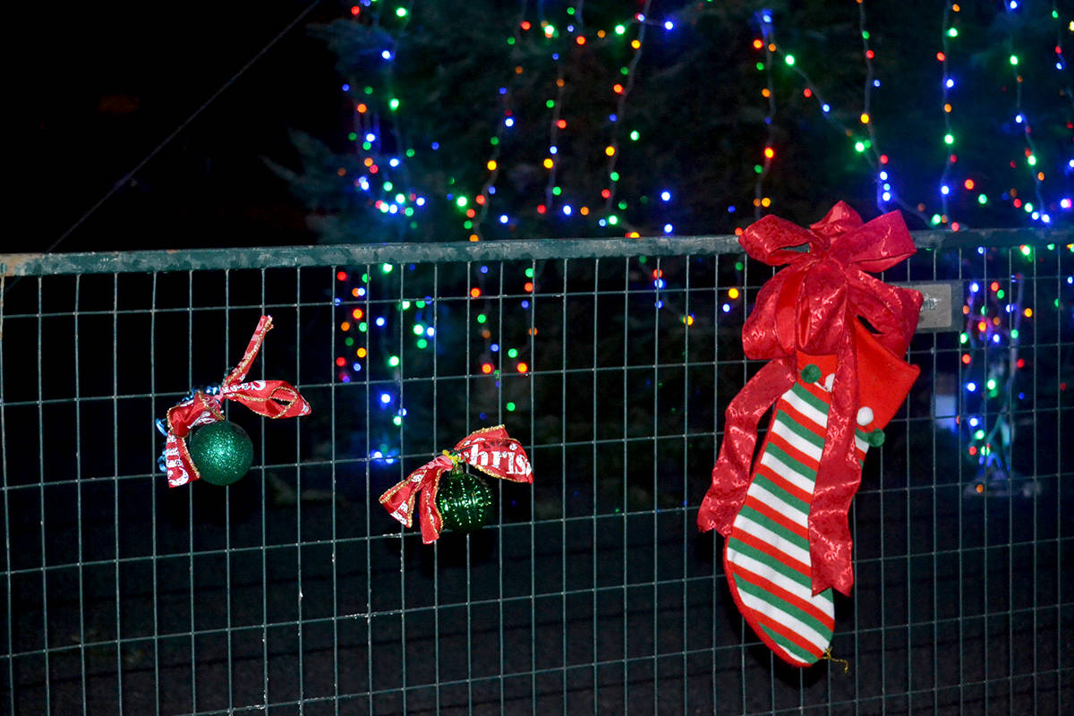 The Aldergrove Business Association is encouraging people to put red ribbons on the fence surrounding the Christmas tree downtown. (Ryan Uytdewilligen/Aldergrove Star)