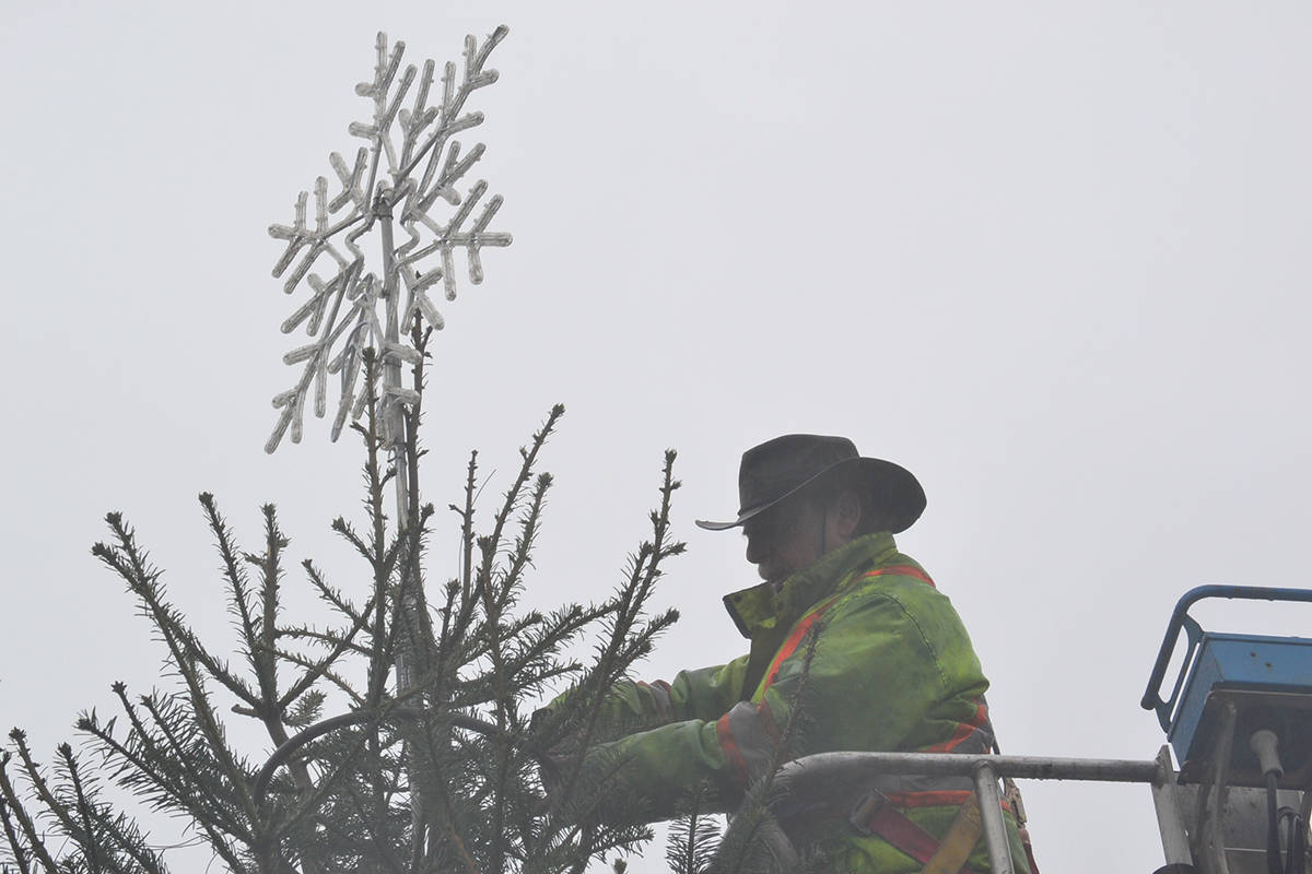 A 27-foot Christmas tree was decorated on Tuesday, Dec. 8, in the vacant lot where the Alder Inn used to stand. (Ryan Uytdewilligen/Aldergrove Star)