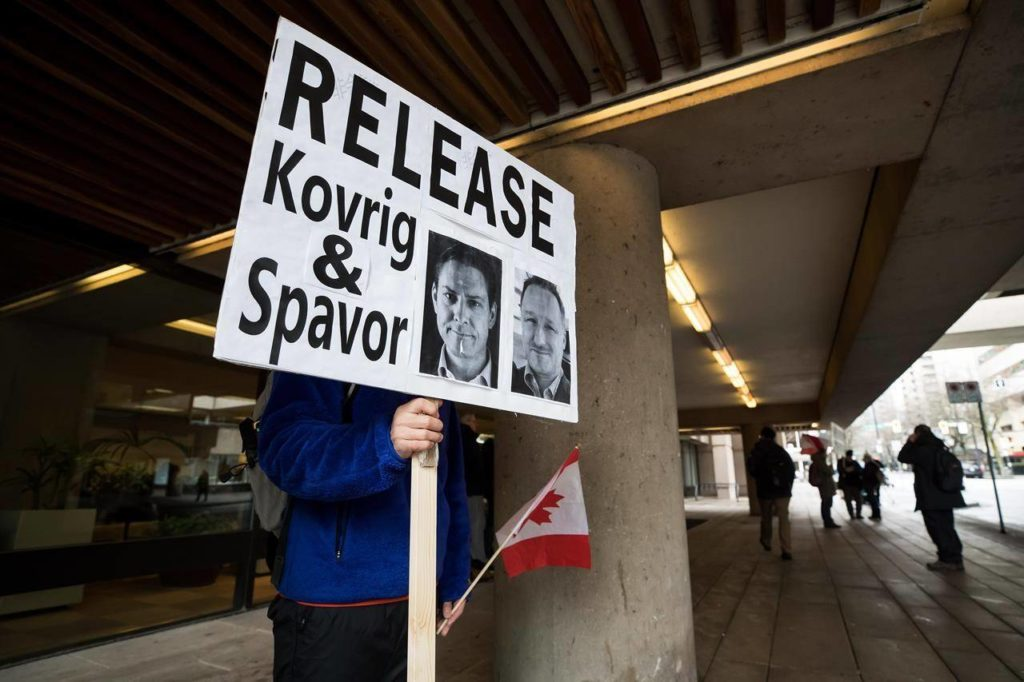 A young man holds a sign bearing photographs of Michael Kovrig and Michael Spavor, who have been detained in China for more than a year, outside B.C. Supreme Court where Huawei chief financial officer Meng Wanzhou was attending a hearing, in Vancouver, on Tuesday January 21, 2020. In his darkest moments, Michael Kovrig draws strength from knowing that his fellow Canadians and people around the world are working to free him and Michael Spavor from their respective Chinese prison cells. THE CANADIAN PRESS/Darryl Dyck