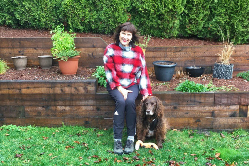 Lynne Smith and her dog Chester pose in this undated handout photo. Smith has applied for a job at a long-term care facility in Abbotsford, B.C., and says she'll even clean toilets so she can see her husband. THE CANADIAN PRESS/HO, Lynne Smith *MANDATORY CREDIT*