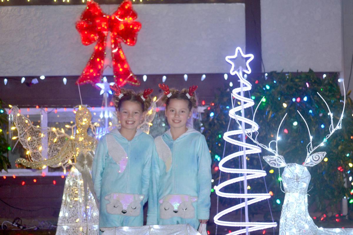 Ellexis and Ella Wejr agreed the the reindeer was their favourite decoration in their front yard this year. (Ryan Uytdewilligen/Aldergrove Star)