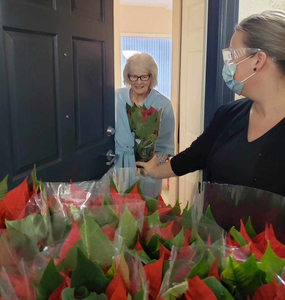 Jessie Vander Eyk wanted some local seniors to know people were thinking about them and with the help of some local students, delivered 200 poinsettias to a local seniors residence. Staff safely distributed the gifts. (Jessie Vander Eyk/Special to the Langley Advance Times)