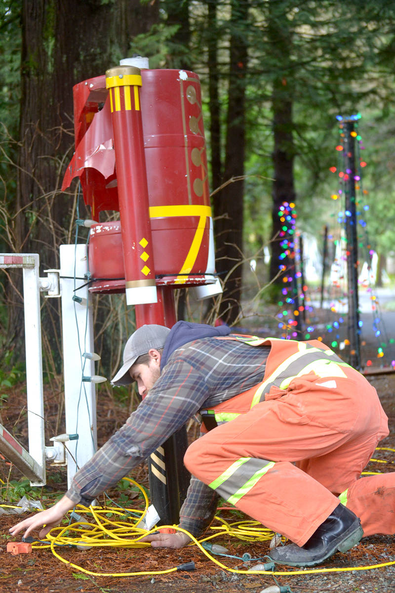 Township employees test and finalize the Christmas light displays at Williams Park. (Ryan Uytdewilligen/Aldergrove Star)