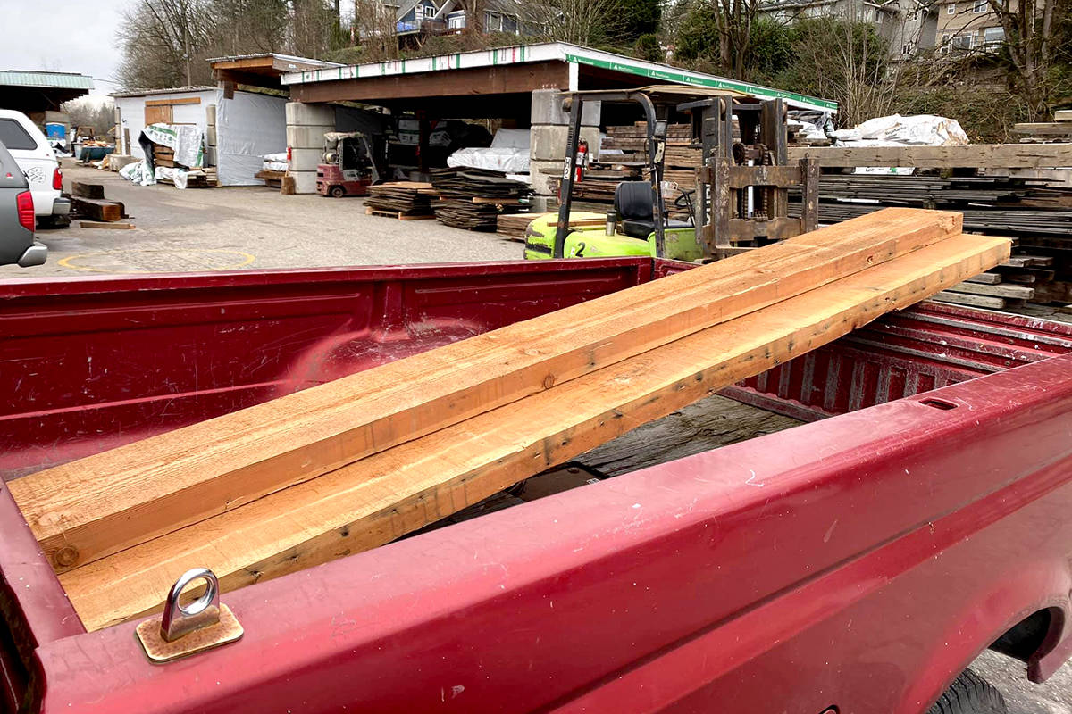 Woodworker Wally Martin picked up a few pieces of lumber that was part of the now toppled Alder Inn. (Wally Marin/Special to The Star)