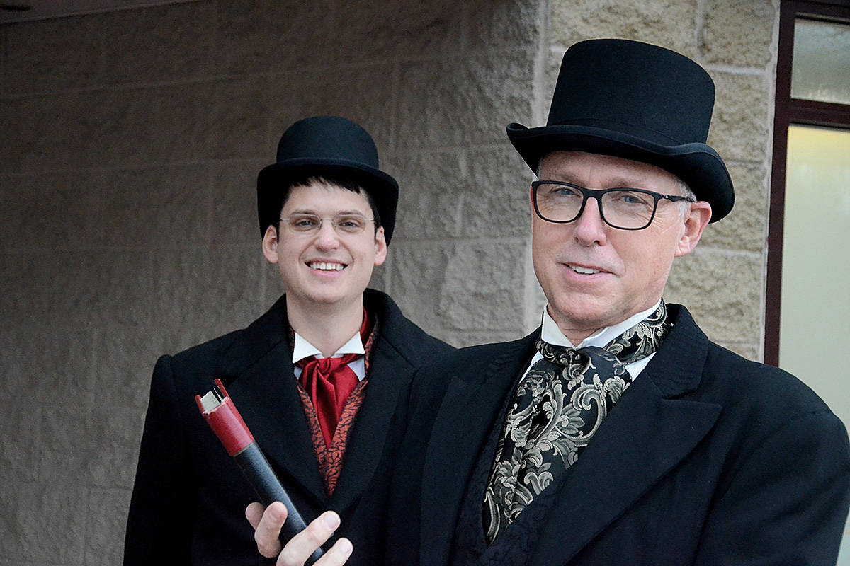 """Kyle """"Bob Cratchit"""" Murray (left) and Wayne """"Jacob Marley"""" Kuyer are cutting back on the in-person visits this year, but still collecting for charities that help kids and families. (Matthew Claxton/Langley Advance Times)"""