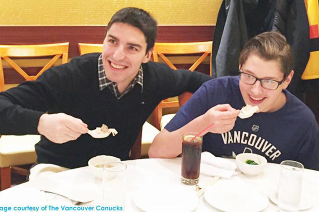 Vancouver Canuck Alex Burrows, left, and Ben, 14, right, enjoy a bowl of wonton. (Derek Jory/Vancouver Canucks)