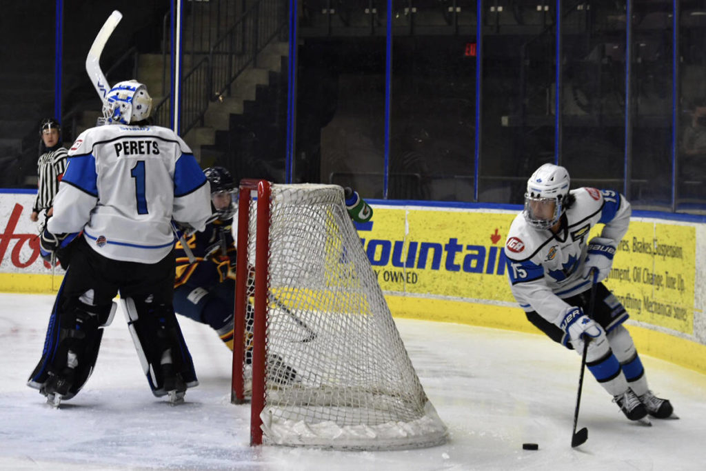 Vees goalkeeper Yaniv Perets stands watch while Tyler Ho takes the puck around the back of the net in the last game of the Okanagan Cup's round robin stage on Nov. 7. (Brennan Phillips - Western News)