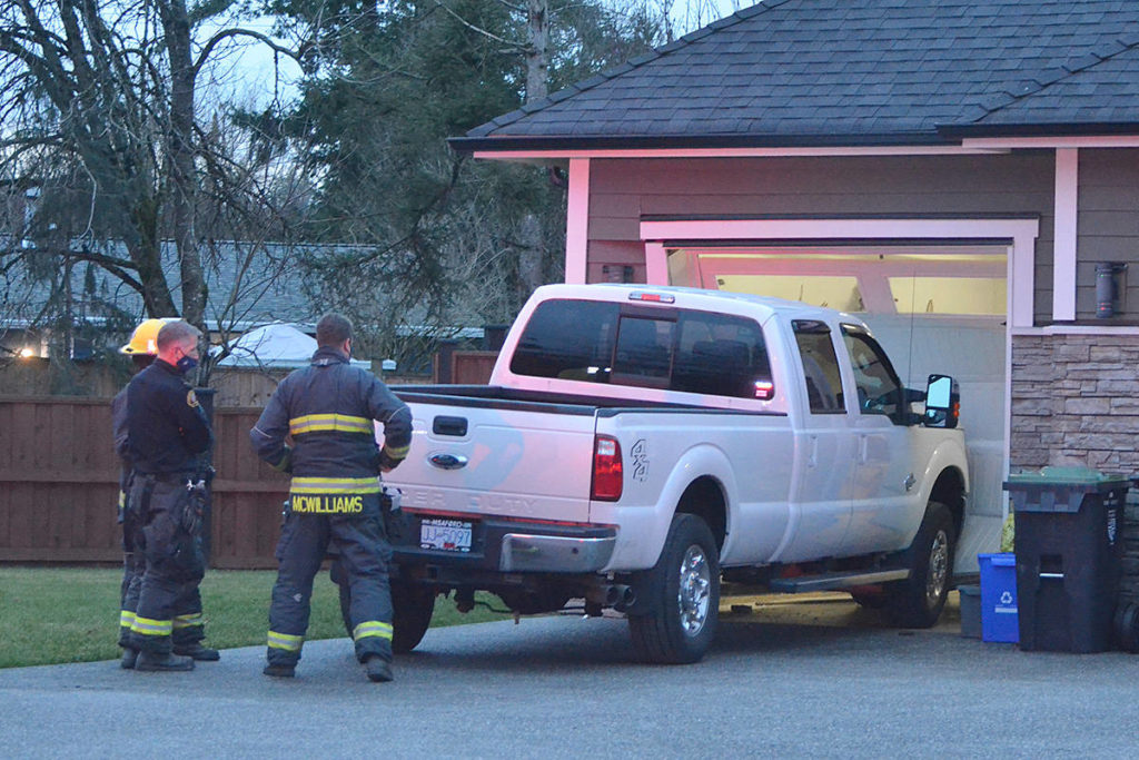 Langley Township firefighters at the crash where a truck hit a garage door in Murrayville. (Matthew Claxton/Langley Advance Times)