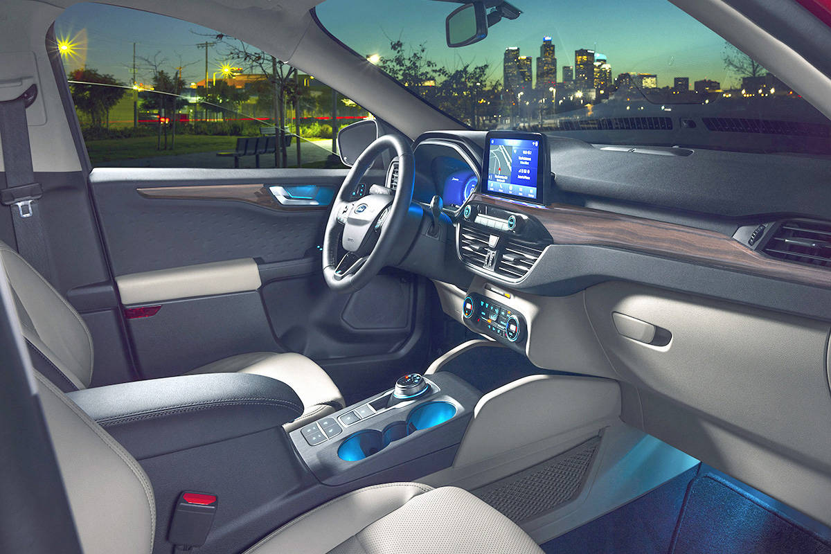 Two obvious changes to the 2020 Escape's interior include a touch-screen that juts out of the dash, and a shift dial for the transmission. PHOTO: FORD
