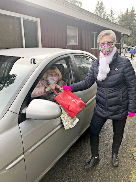 Gifts were distributed to some local seniors on Thursday, Dec. 10, 2020. Irene Jamieson (in car) received gifts from Esther Gallanger. (Bria Communities/Special to the Langley Advance Times)