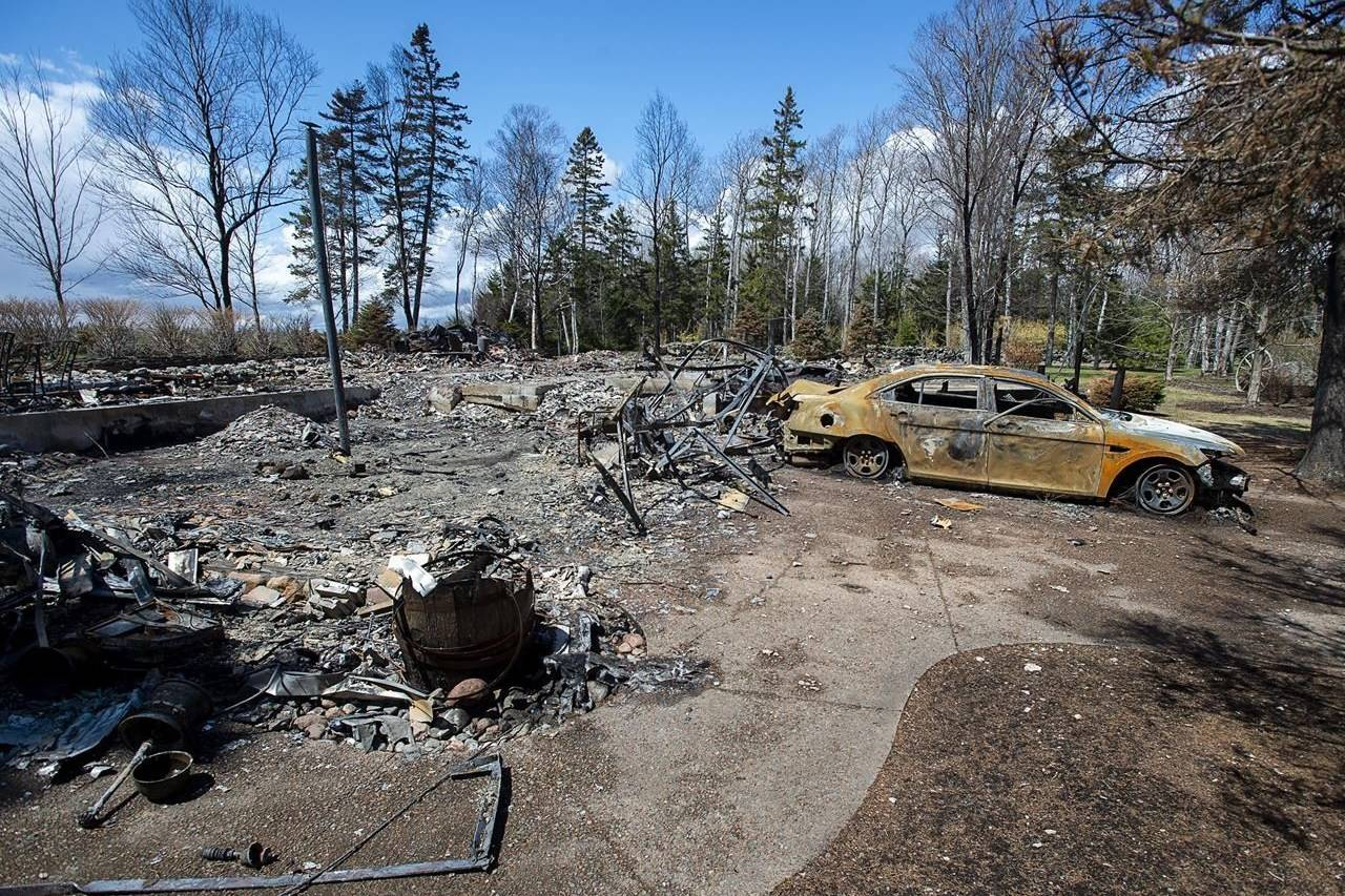 """A fire-destroyed property registered to Gabriel Wortman at 200 Portapique Beach Road is seen in Portapique, N.S. on Friday, May 8, 2020. Newly released documents suggest the gunman behind the April mass shooting in Nova Scotia had planned to """"get"""" a pair of people in Halifax during his murderous rampage, but the Mounties were warned by his common-law spouse while he was on the loose north of the city. THE CANADIAN PRESS/Andrew Vaughan"""