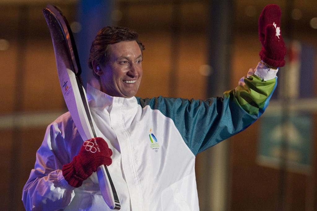 Wayne Gretzky waves to the crowd after lighting the Olympic cauldron during the opening ceremonies at the 2010 Vancouver Olympic Winter Games in Vancouver on Friday Feb. 12, 2010. THE CANADIAN PRESS/Adrian Wyld